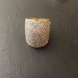 Gold ring with pave stones.